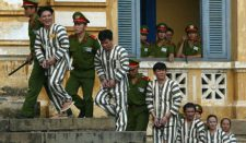 Some of the 155 accused wearing their striped prison clothes