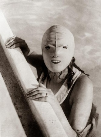 A mildly terrifying 1920s full faced swimming mask designed to protect women from the sun
