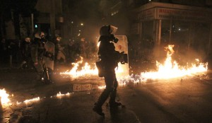 Greek riot police clash with students on killing anniversary