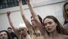 Femen clashes with anti-gay marriage protests in France over government bill