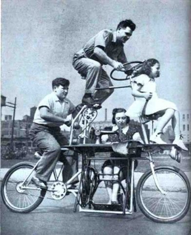 A bicycle that fits a family of four, including a sewing machine. (1939).