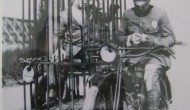 1921: A police officer on a Harley and an old fashioned mobile holding cell