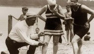 1920 An beach official measures bathing suits to ensure they aren't too short