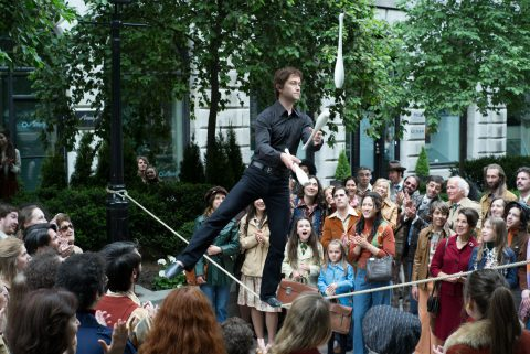 Philippe Petit (Joseph Gordon-Levitt) balances on a loose hemp rope juggling bowling pins in TriStar Pictures' THE WALK.