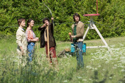L - R: Philippe Petit (Joseph Gordon-Levitt), Annie (Charlotte Le Bon) and Jeff / Jean-François (César Domboy) look on as Jean-Louis (Clément Sibony) lets the arrow fly in TriStar Pictures' THE WALK.